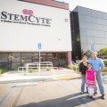 Itzel Cervantes and parents next to the StemCyte laboratory